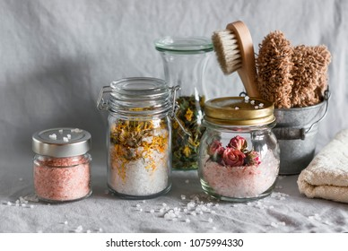 Homemade sea salt bath - calendula, pink himalayan, rose salt and bath accessories. Health, beauty, regeneration, skin cleansing concept. Flat lay
