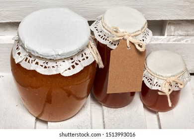 Homemade seasonal preparations. Beautifully packaged jars of apple jam. Covered with paper and tied with a cord.