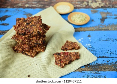 Homemade seed crackers made from bell pepper, sun dried tomato, sunflower seed, sesame seed, hemp seed and flax seeds.