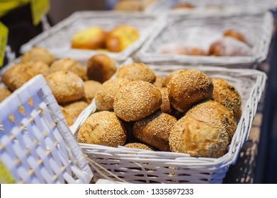 homemade sesame buns, in baking tray