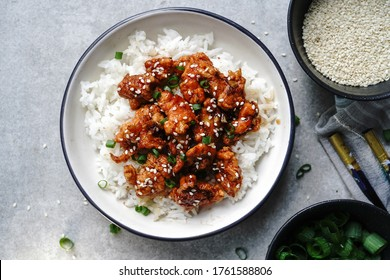 Homemade sesame Chicken served with Jasmine white rice, selective focus