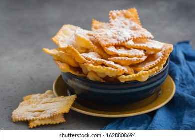"Homemade ""sfrappole"" or ""chiacchiere"". Italian traditional sweet crisp pastry,  deep-fried and sprinkled with powdered sugar. Commonly eaten during Carnival and on Fat Thursday."
