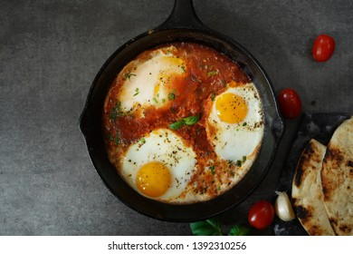 Homemade Shakshouka - Middle Eastern breakfast Eggs poached in spicy tomato sauce