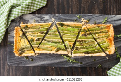 Homemade shortcrust quiche made with green asparagus