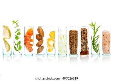 Homemade skin care and body scrubs with natural ingredients aloe vera,lemon,himalayan salt ,peppermint ,lemon,rosemary,almonds,ginger and honey pollen in glass bottles isolate on white background.