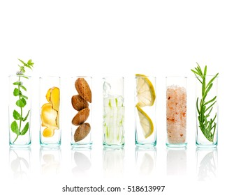Homemade skin care and body scrubs with natural ingredients aloe vera ,himalayan salt ,peppermint ,lemon slice,rosemary,almonds and ginger in glass bottles isolate on white background.