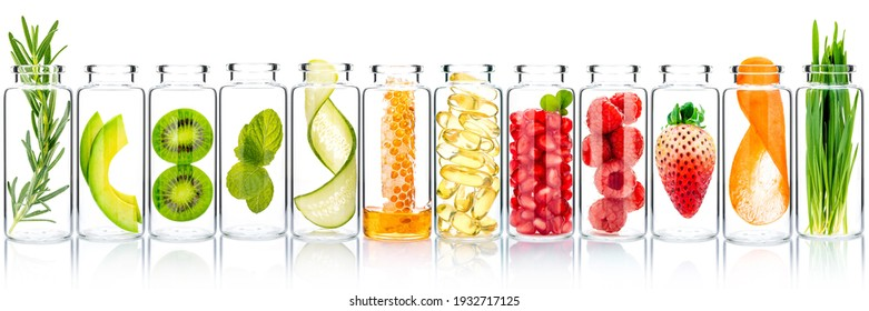 Homemade skin care with fruits ingredients avocado ,orange ,blueberry ,pomegranate ,kiwi ,lemon slice ,cucumber ,tamarind ,strawberry and raspberry in glass bottles isolated on white background.