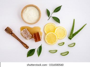 Homemade skin care and hair mask with natural ingredients yogurt,aloe vera ,lemon and honey set up on white background.Best natural hair care for long, strong and beautiful hair.