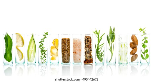 Homemade skin care with natural ingredients aloe vera, lemon, cucumber, himalayan salt, peppermint, rosemary, almonds, cucumber, ginger and honey pollen isolated on white background. - Shutterstock ID 495442672