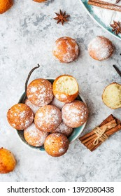 homemade small balls cottage cheese doughnuts in powdered sugar