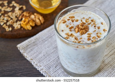 Homemade smoothie made from oats milk, nuts and honey