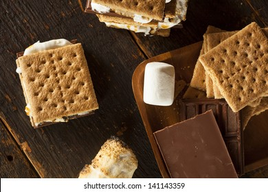 Homemade S'more with chocolate and marshmallow on a graham cracker