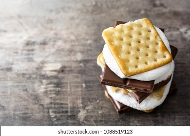 Homemade smores on wooden table. Copyspace