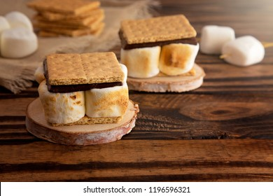 Homemade Smores on a Wooden Table Which are the Perfect Camping Treat