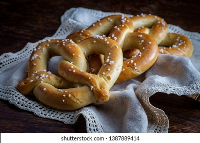 Homemade soft pretzels on wooden table with rustic lighting