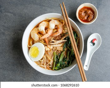 Homemade soup noodle meal / Spicy Prawn Noodle / A delicacy made popular by the Hokkien Chinese in Malaysia and Singapore
