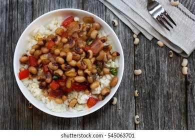 Homemade Southern Hoppin John or Carolina peas and rice served in a white bowl