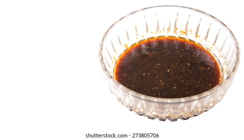 Homemade soy sauce in a bowl over white background