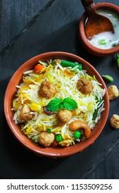 Homemade Soyabean / Soy Chunks biryani or Pulao/ Pilaf in a clay pot