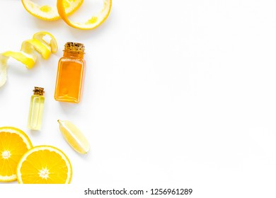 homemade spa with citrus cosmetic oil on white background top view mock-up