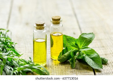 homemade spa with herbal extract in oil on wooden table background