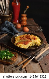 Homemade spanish omlette tortilla on a wooden rustic table. Countyside. Copy space.