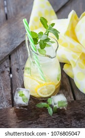 Homemade sparkling lemonade with mint leaves and fresh lemons