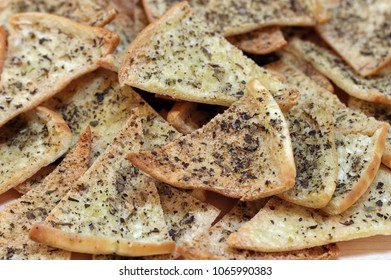 Homemade Spicy Pita Chips, Macro view, full screen with selective focus.