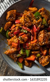 Homemade Spicy Szechuan Chicken with Peppers and Rice
