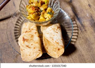 Homemade Spicy Vegan made from banana, kele ki sabji & prantha