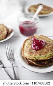 Homemade spinach pancakes with lingonberry jam