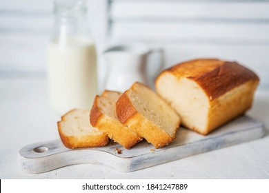 Homemade sponge cake or chiffon cake on white table, soft and moist dessert with milk. Homemade bakery concept for background, copy space, selective focus. Pound butter fluffy pie, white background.