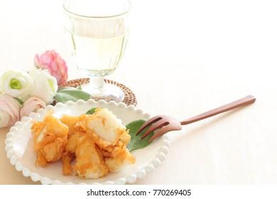 Homemade squid deep fried on dish and wine