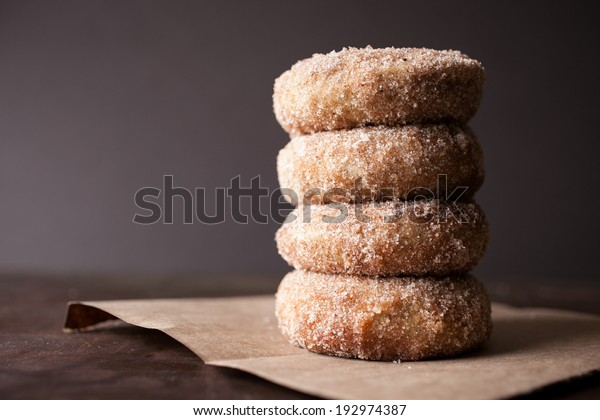 Homemade stack of donuts frosted with cinnamon and sugar