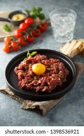 Homemade steak tartare with egg yolk