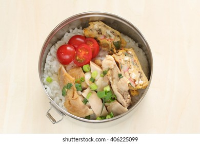 Homemade steamed chicken and egg roll packed lunch box