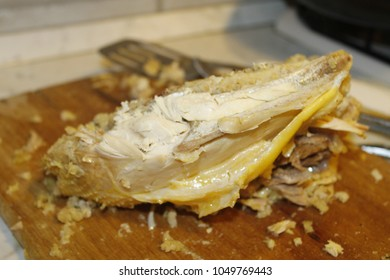 homemade stuffed capon on wooden cutting board
