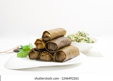Homemade Stuffed Grape Leaves on white background - Dolomades-Sarma