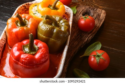 homemade, stuffed peppers. with a filling of basil, spinach, cheese and spices. with gravy from fresh home-made tomatoes. made in a rustic style.
