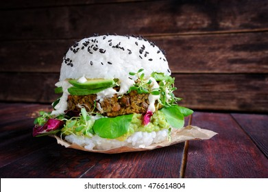 Homemade sushi vegan burger with lentil, avocado, alfalfa sprouts and cashew sauce