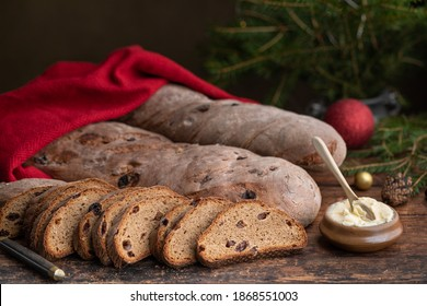 Homemade swedish traditional wort bread, brown christmas bread with raisins. The bread is made with beer and swedish traditional julmust drink. With copy space.