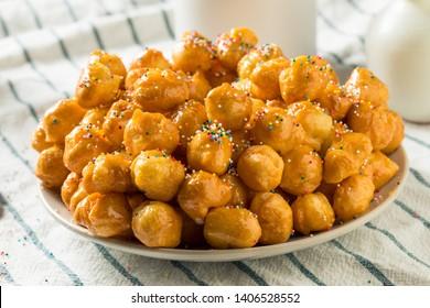 Homemade Sweet Italian Struffoli with Honey and Sprinkles