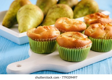 Homemade sweet muffins with pear stuffing.