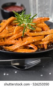 Homemade sweet potato fries with salt and pepper