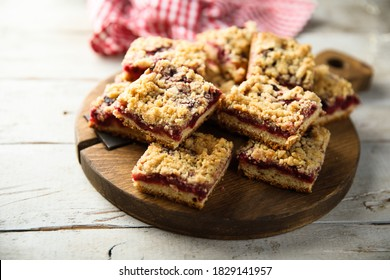 Homemade sweet red berry squares with streusel