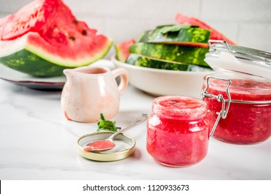 Homemade sweet watermelon jam, white marble background copy space