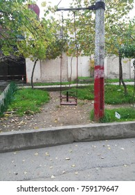 Homemade swing hanging on a pillar