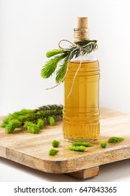 Homemade syrup from young spruce sprouts in a bottle. Herbal medicine concept. Selective focus.