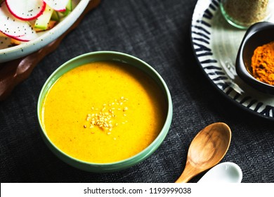 Homemade Tahini with Turmeric salad dressing in a bowl by some ingredients