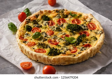 Homemade tart with broccoli, tomatoes and blue cheese.